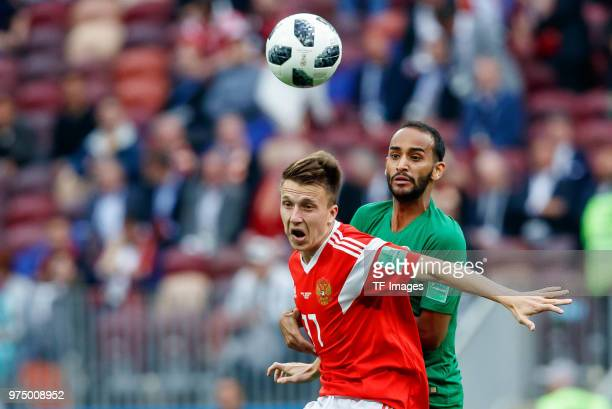 Aleksandr Golovin of Russia and Adullah Otayf of Saudi Arabia battle for the ball during the 2018 FIFA World Cup Russia group A match between Russia...