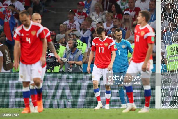 Aleksandr Golovin of Russia and his teammates react after Domagoj Vida of Croatia scored a goal to make it 12 in extra time during the 2018 FIFA...