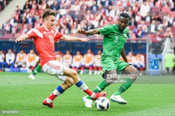 Aleksandr Golovin of Russia and Osama Hawsawi of Saudi Arabia during the 2018 FIFA World Cup Russia group A match between Russia and Saudi Arabia at...
