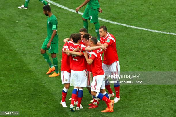 Aleksandr Golovin of Russia celebrates scoring a goal to make it 50 with his teammates during the 2018 FIFA World Cup Russia group A match between...