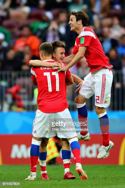 Aleksandr Golovin of Russia celebrates scoring his sides fifth goal with teammates Roman Zobnin and Mario Fernandes during the 2018 FIFA World Cup...