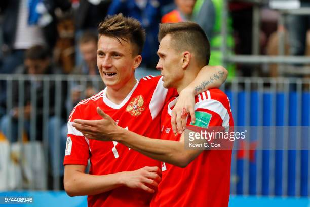 Aleksandr Golovin of Russia celebrates victory with team mate Denis Cheryshev of Russia during the 2018 FIFA World Cup Russia Group A match between...