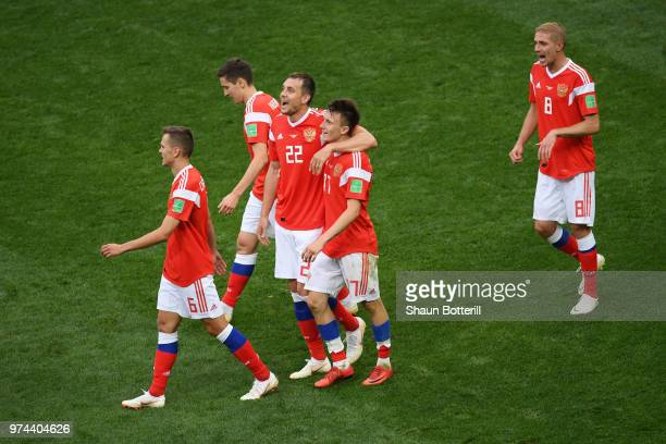 Aleksandr Golovin of Russia celebrates with team mates after scoring his team's fifth goal during the 2018 FIFA World Cup Russia Group A match...
