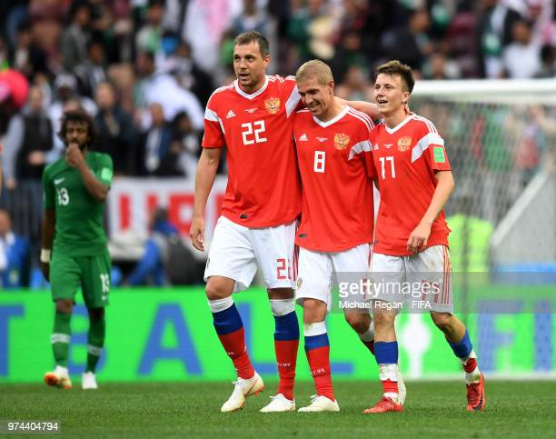 Aleksandr Golovin of Russia celebrates with teammates after scoring his team's fifth goal during the 2018 FIFA World Cup Russia Group A match between...