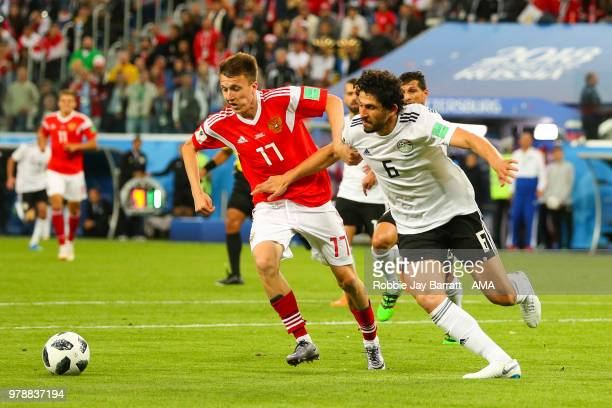 Aleksandr Golovin of Russia competes with Ahmed Hegazy of Egypt during the 2018 FIFA World Cup Russia group A match between Russia and Egypt at Saint...