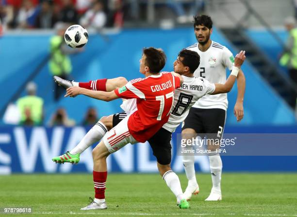 Aleksandr Golovin of Russia controls the ball under pressure of Tarek Hamed of Egypt during the 2018 FIFA World Cup Russia group A match between...