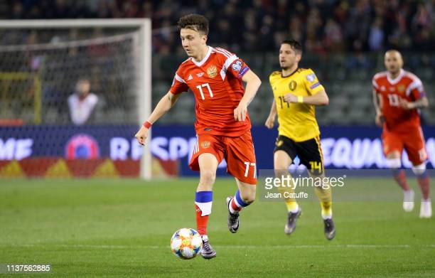 Aleksandr Golovin of Russia drives the ball during the 2020 UEFA European Championships group I qualifying match between Belgium and Russia at King...
