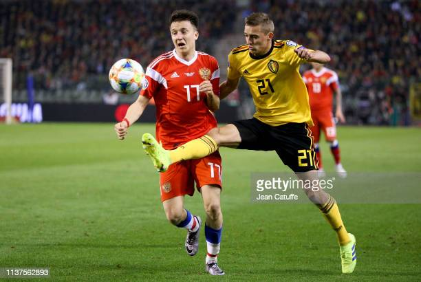 Aleksandr Golovin of Russia fights for the ball with Timothy Castagne of Belgium during the 2020 UEFA European Championships group I qualifying match...