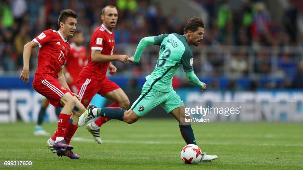Aleksandr Golovin of Russia fouls Adrien Silva of Portugal during the FIFA Confederations Cup Russia 2017 Group A match between Russia and Portugal...