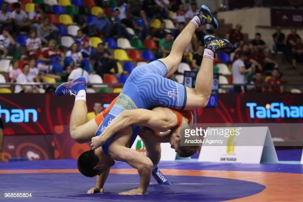 Aleksandr Golovin of Russia in action against Vladen Kozliuk of Ukraine during third day of Mens final greco roman style 97kg category match within...