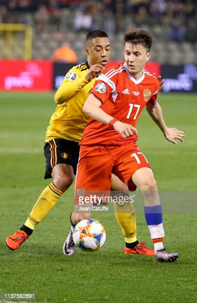 Aleksandr Golovin of Russia is challenged by Youri Tielemans of Belgium during the 2020 UEFA European Championships group I qualifying match between...