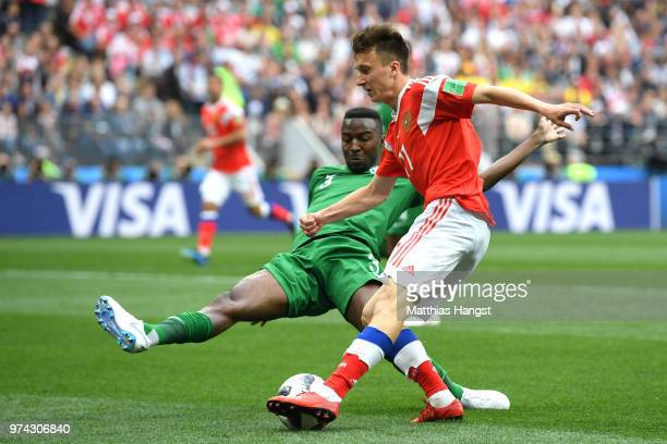 Aleksandr Golovin of Russia is tackled by Osama Hawsawi of Saudi Arabia during the 2018 FIFA World Cup Russia Group A match between Russia and Saudi...