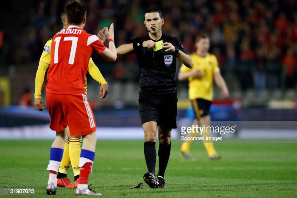 Aleksandr Golovin of Russia referee Ovidiu Hategan during the EURO Qualifier match between Belgium v Russia at the Koning Boudewijn Stadium on March...