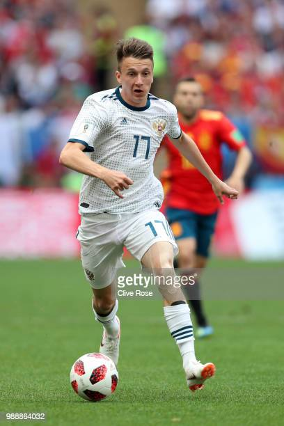 Aleksandr Golovin of Russia runs with the ball during the 2018 FIFA World Cup Russia Round of 16 match between Spain and Russia at Luzhniki Stadium...