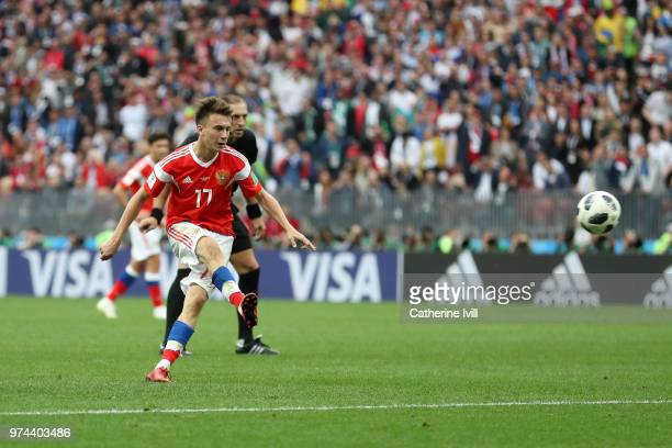 Aleksandr Golovin of Russia scores his sides fifth goal from a free kick during the 2018 FIFA World Cup Russia Group A match between Russia and Saudi...