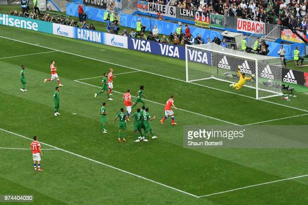 Aleksandr Golovin of Russia scores his sides fifth goal from a free kick pass goalkeeper Abdullah Almuaiouf of Saudi Arabia during the 2018 FIFA...