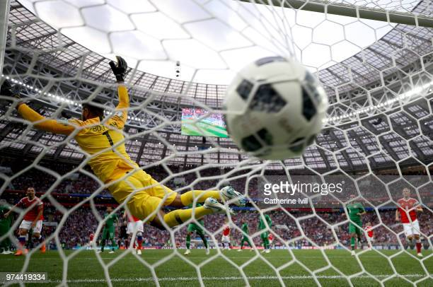 Aleksandr Golovin of Russia scores his team's fifth goal past Abdullah Al Muaiouf of Saudi Arabia during the 2018 FIFA World Cup Russia Group A match...