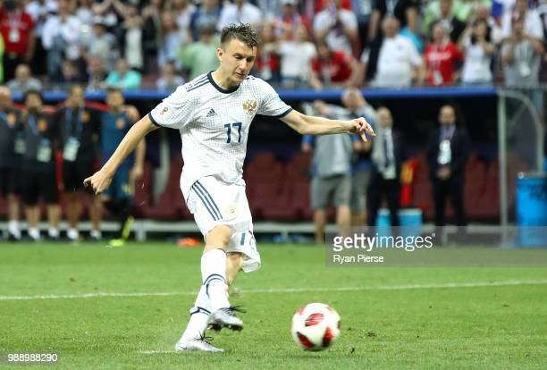 Aleksandr Golovin of Russia scores his team's third penalty in the penalty shoot out during the 2018 FIFA World Cup Russia Round of 16 match between...