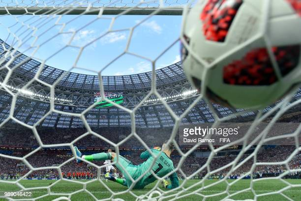 Aleksandr Golovin of Russia scores past David De Gea of Spain his team's third penalty in the penalty shoot out during the 2018 FIFA World Cup Russia...