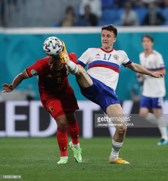 Aleksandr Golovin of Russia stretches for the ball with Youri Tielemans of Belgium during the UEFA Euro 2020 Championship Group B match between...