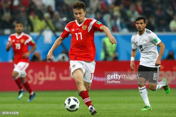 Aleksandr Golovin of the Russia national football team vie for the ball during the 2018 FIFA World Cup match first stage Group A between Russia and...