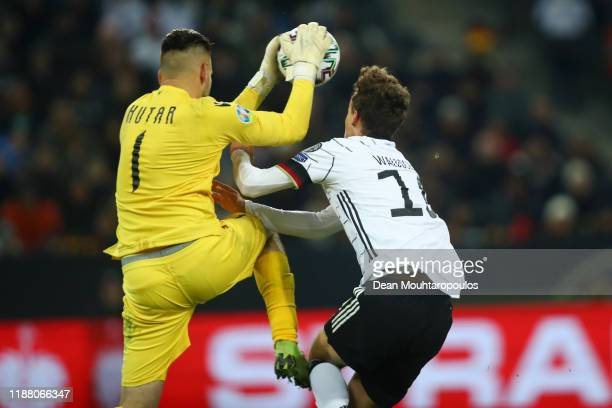Aleksandr Gutor of Belarus collides with Luca Waldschmidt of Germany during the UEFA Euro 2020 Group C Qualifier match between Germany and Belarus on...