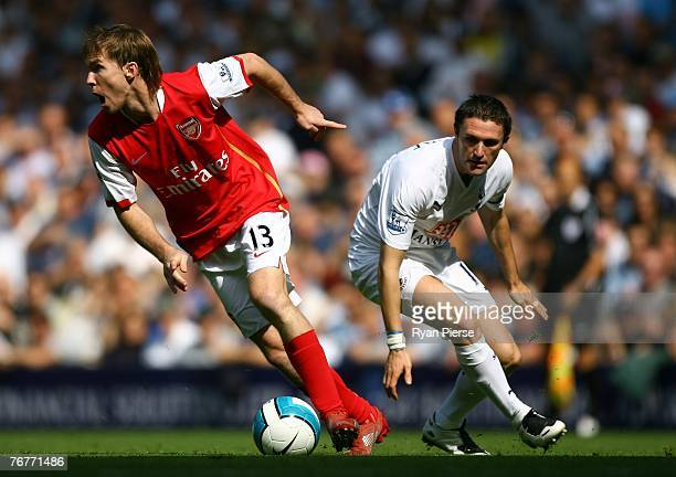 Aleksandr Hleb of Arsenal beats Robbie Keane of Tottenham during the Barclays Premier League match between Tottenham Hotspur and Arsenal at White...