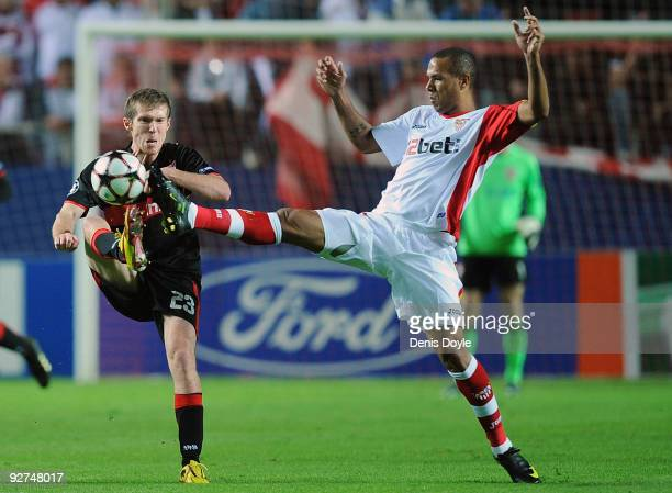 Aleksandr Hleb of VfB Stuttgart is tackled by Luis Fabiano of Sevilla during the UEFA Champions League Group G match between Sevilla and VfB...