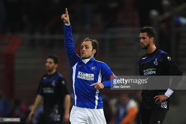 Aleksandr Iashvili of Karlsruhe celebrates his team's second goal as Olivier Veigneau and Stefan Maierhofer of Duisburg react during the Second...
