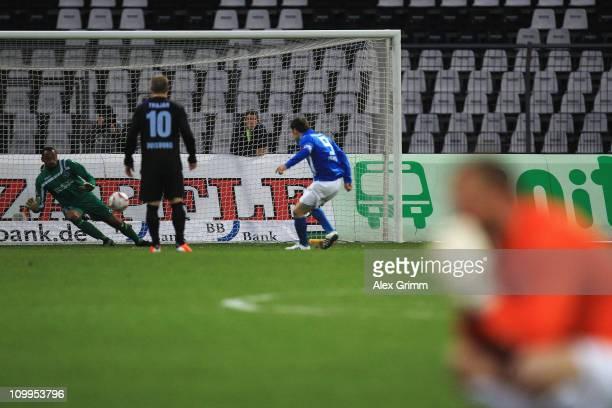 Aleksandr Iashvili of Karlsruhe scores his team's second goal against goalkeeper David Yelldell of Duisburg during the Second Bundesliga match...