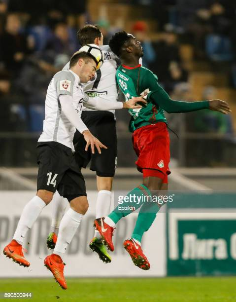 Aleksandr Karnitsky and Rustem Mukhametshin of FC Tosno vie for a header with Eder of FC Lokomotiv Moscow during the Russian Football League match...