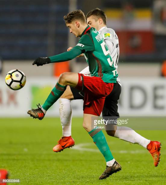 Aleksandr Karnitsky of FC Tosno and Aleksei Miranchuk of FC Lokomotiv Moscow vie for the ball during the Russian Football League match between FC...