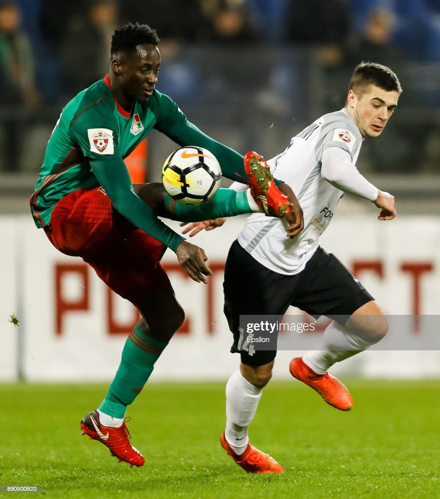 Aleksandr Karnitsky (R) of FC Tosno and Eder of FC Lokomotiv Moscow vie for the ball during the Russian Football League match between FC Tosno and FC Lokomotiv Moscow on December 11, 2017 at Petrovsky Stadium in Saint Petersburg, Russia.