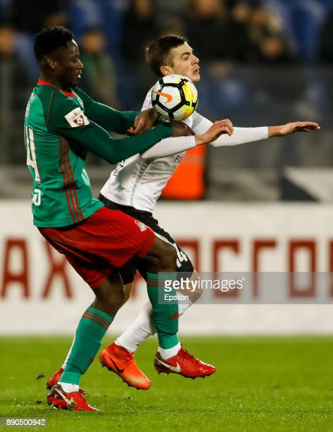 Aleksandr Karnitsky of FC Tosno and Eder of FC Lokomotiv Moscow vie for the ball during the Russian Football League match between FC Tosno and FC...