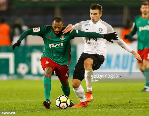 Aleksandr Karnitsky of FC Tosno and Manuel Fernandes of FC Lokomotiv Moscow vie for the ball during the Russian Football League match between FC...