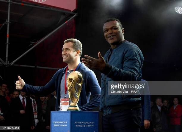 Aleksandr Kerzhakov and Marcel Desailly pose for a photo during the official opening of the FIFA Fan Fest at Vorobyovy Gory on June 10 2018 in Moscow...