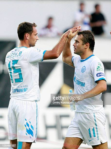 Aleksandr Kerzhakov and Roman Shirokov of FC Zenit St Petersburg celebrate after scoring a goal during the Russian Football League Championship match...