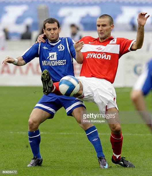 Aleksandr Kerzhakov of FC Dynamo Moscow competes for the ball with Ignas Dedura of FC Spartak Moscow during the Russian Football League Championship...
