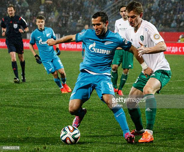 Aleksandr Kerzhakov of FC Zenit St Petersburg and Andrei Semyonov of FC Terek Grozny vie for the ball during the Russian Football League Championship...