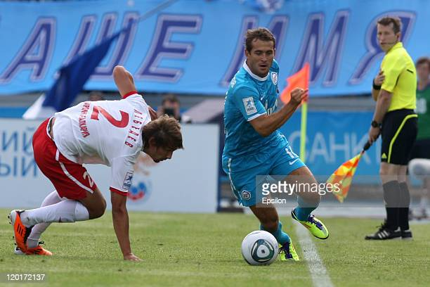 Aleksandr Kerzhakov of FC Zenit St Petersburg battles for the ball with Yuri Lebedev of FC Spartak Nalchik during the Russian Football League...