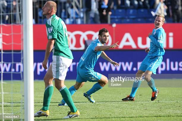 Aleksandr Kerzhakov of FC Zenit St. Petersburg celebrates after scoring a goal with Aleksandr Anyukov during the Russian Premier League match between...