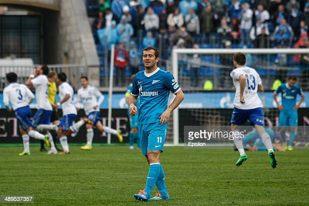 Aleksandr Kerzhakov of FC Zenit St Petersburg reacts as FC Dynamo Moscow players celebrate a goal during the Russian Football League Championship...