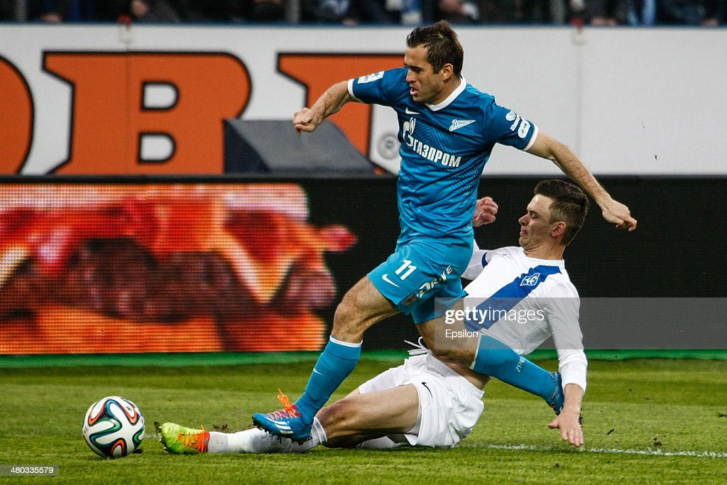 Aleksandr Kerzhakov of FC Zenit St. Petersburg (Top) vies for the ball with Ivan Taranov of PFC Krylia Sovetov Samara during the Russian Football League Championship match between FC Zenit St. Petersburg and FC Krylia Sovetov Samara at the Petrovsky stadium on March 24, 2014 in St. Petersburg, Russia.