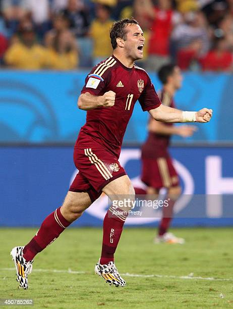 Aleksandr Kerzhakov of Russia celebrates after scoring his team's first goal during the 2014 FIFA World Cup Brazil Group H match between Russia and...