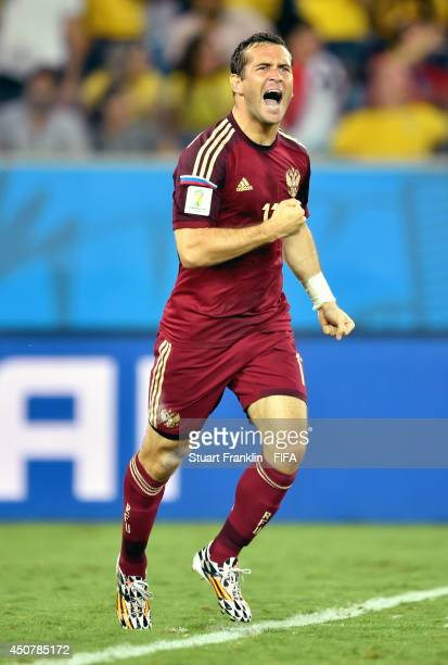 Aleksandr Kerzhakov of Russia celebrates after scoring the team's first goal during the 2014 FIFA World Cup Brazil Group H match between Russia and...