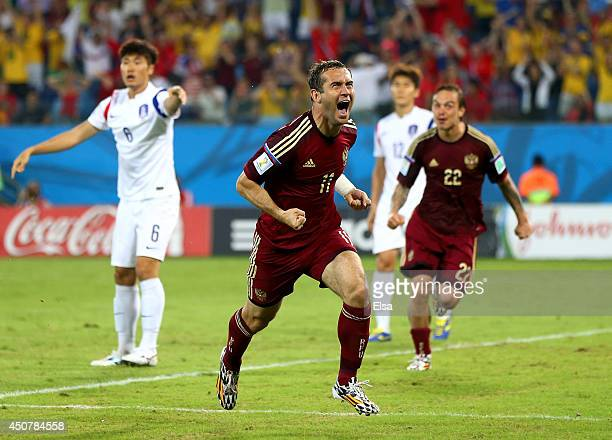 Aleksandr Kerzhakov of Russia celebrates scoring his team's first goal during the 2014 FIFA World Cup Brazil Group H match between Russia and South...