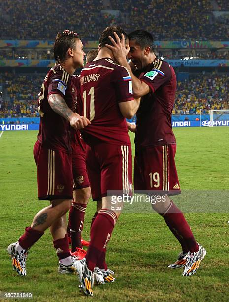 Aleksandr Kerzhakov of Russia celebrates with teammates Andrey Yeshchenko and Alexander Samedov after scoring his team's first goal during the 2014...