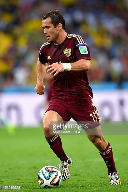 Aleksandr Kerzhakov of Russia controls the ball during the 2014 FIFA World Cup Brazil Group H match between Algeria and Russia at Arena da Baixada on...