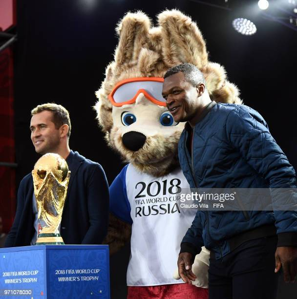 Aleksandr Kerzhakov the Official Mascotte Zabivaka and Marcel Desailly pose fro a photo during the official opening of the FIFA Fan Fest at Vorobyovy...