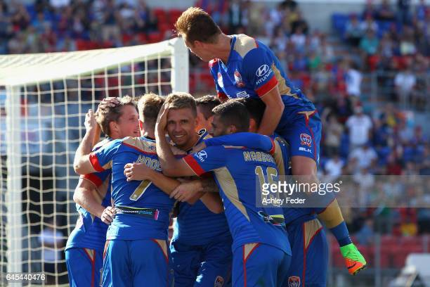 Aleksandr Kokko of the Jets celebrates his goal with team mates during the round 21 ALeague match between the Newcastle Jets and the Central Coast...